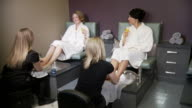 Two women get foot treatments video