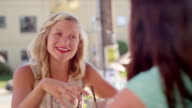 Two women having brunch at a caf_ video