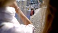 Two women in an unfamiliar city. Two young traveler guided by a paper map on the city's waterfront. video