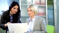 Two women in office video