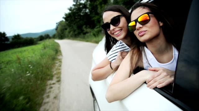 Two women in the car. Slow motion video