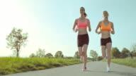 SLO MO TS Two women on their run through countryside video