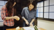 Two Women Preparing a Meal Slicing Onions video