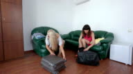 Two women tourists relaxing after trip to summer resort in hotel room video