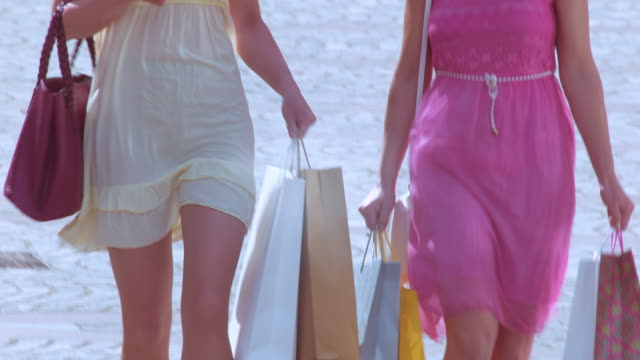 TD Two women walking down the street with shopping bags video