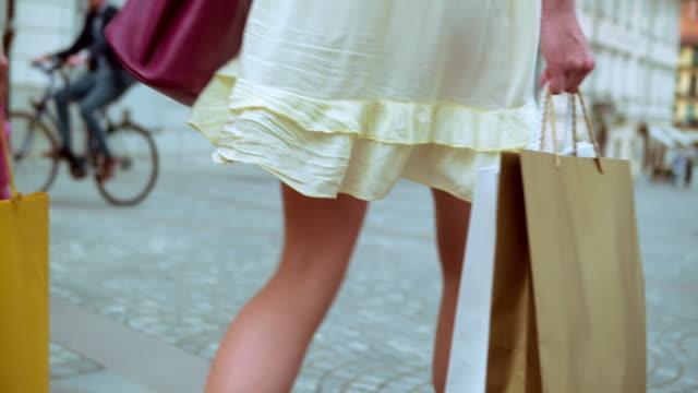 SLO MO Two women walking with shopping bags video