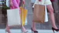 TS Two women with shopping bags crossing a bridge video