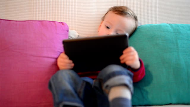 DOLLY: Two year old boy using tablet computer video