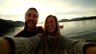 Two young adults capturing travel moments, New Zealand video
