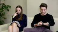 Two young adults in the waiting room video