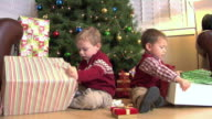Two young boys opening Christmas presents video