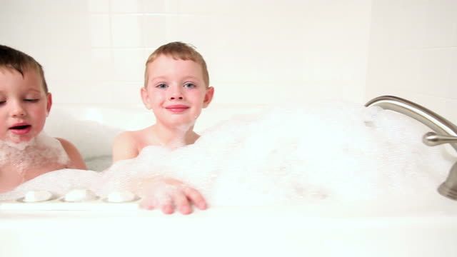 Two young boys playing in bathtub video