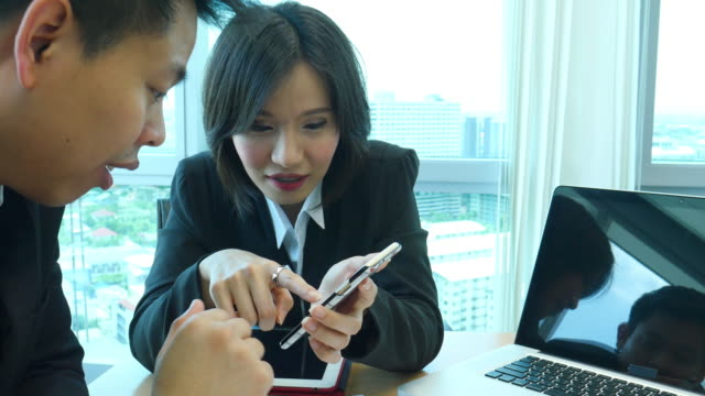 Two young business teamwork talk and discussion video