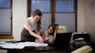 Two young business women working on a serious project. They tense situation, they are confused about the terms and figures video
