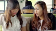 Two Young Businesswomen Meeting In Coffee Shop video
