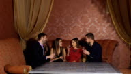 Two young couples in restaurant video