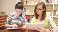 Two young entrepreneur women working in a bookstore. video