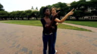 Two Young Female College Students Looking Around College Campus video