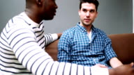 MS TU Two young gay men talking in living room video