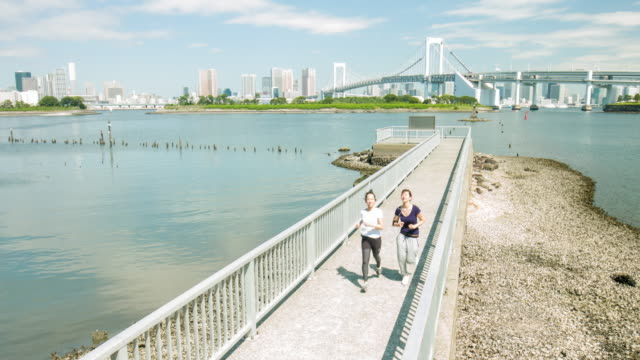 Two young Japanese women running in Tokyo video
