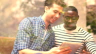 CU Two young men using digital tablet video