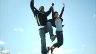 Two young people jumping outside video