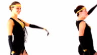 Two young women dancing on a white background. video