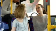 Two Young Women On Bus Journey Together video