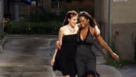 Two young women slow motion having fun in the city video