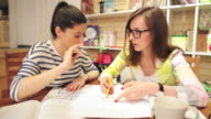 Two young women working in bookstore. video