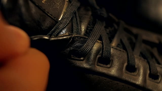 Tying shoelaces close-up video