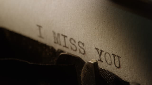 Type bars of old typewriter printing words I MISS YOU video