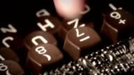 Typewriter. Finger tapping in key. video