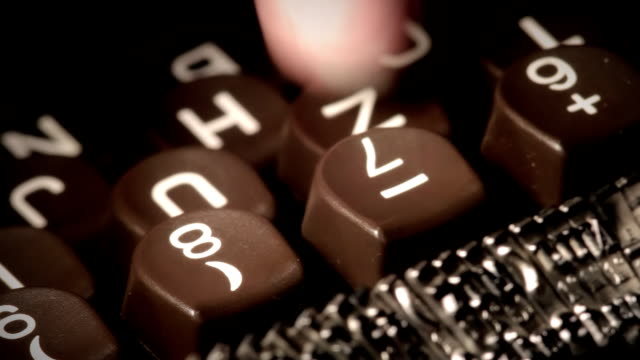 Typewriter. Finger tapping in key. video