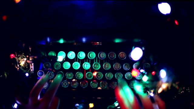 Typewriter, hands, green, blinking, christmas lights, writing, letter to Santa Claus video