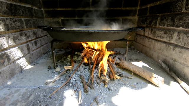 Typical and traditional spanish paella, cooking with natural fire video
