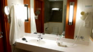 Typical interior design of hotel bathroom, mirror and sink video