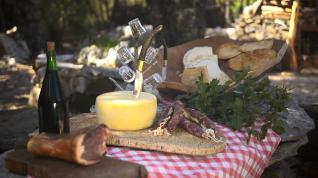 Typical Italian food with ham, cheese, salami and wine video