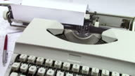 Typical literary formula for beginning of story telling printed on a piece of paper and rolled on the cylinder of a typewriter video