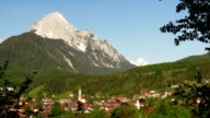 Typical small town in the alps with blue sky video