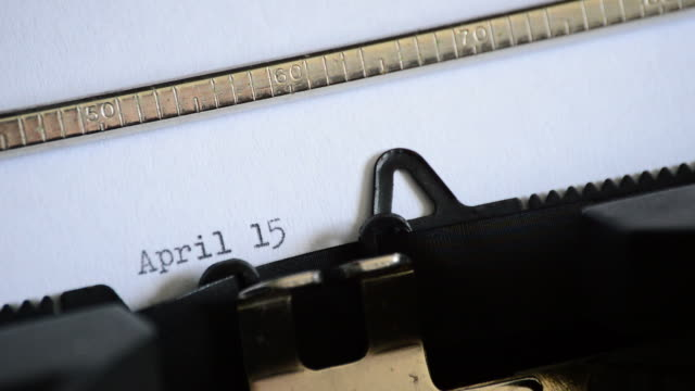 Typing 15 April in a letter with a old manuel typewriter video
