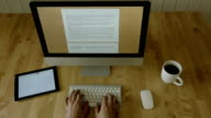 Typing at Light Wooden Desk at Laptop in motion part1 video