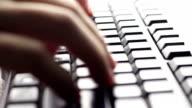 Typing fingers push keyboard video