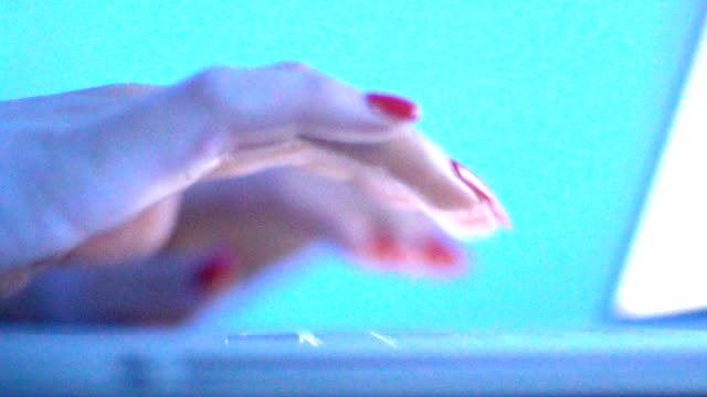 Typing on a laptop keyboard in slow motion. video