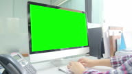 Typing on computer with green screen video