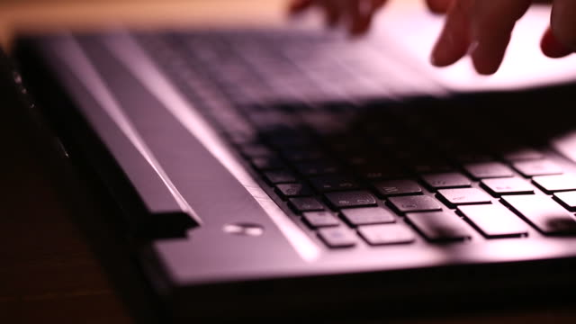 typing on Laptop (dolly shot) video