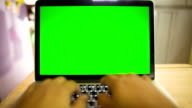 Typing on notebook computer with green screen video