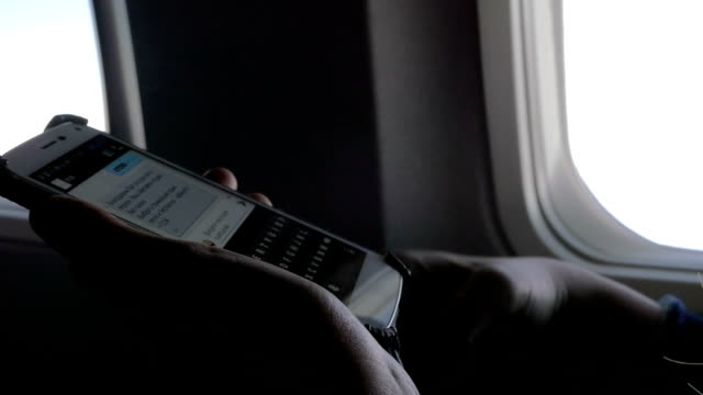 Typing sms on smart phone in the plane video