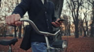 Typing sms while pushing a bicycle video