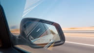 Uae summer day united arab emirates road trip side mirror view 4k time lapse video